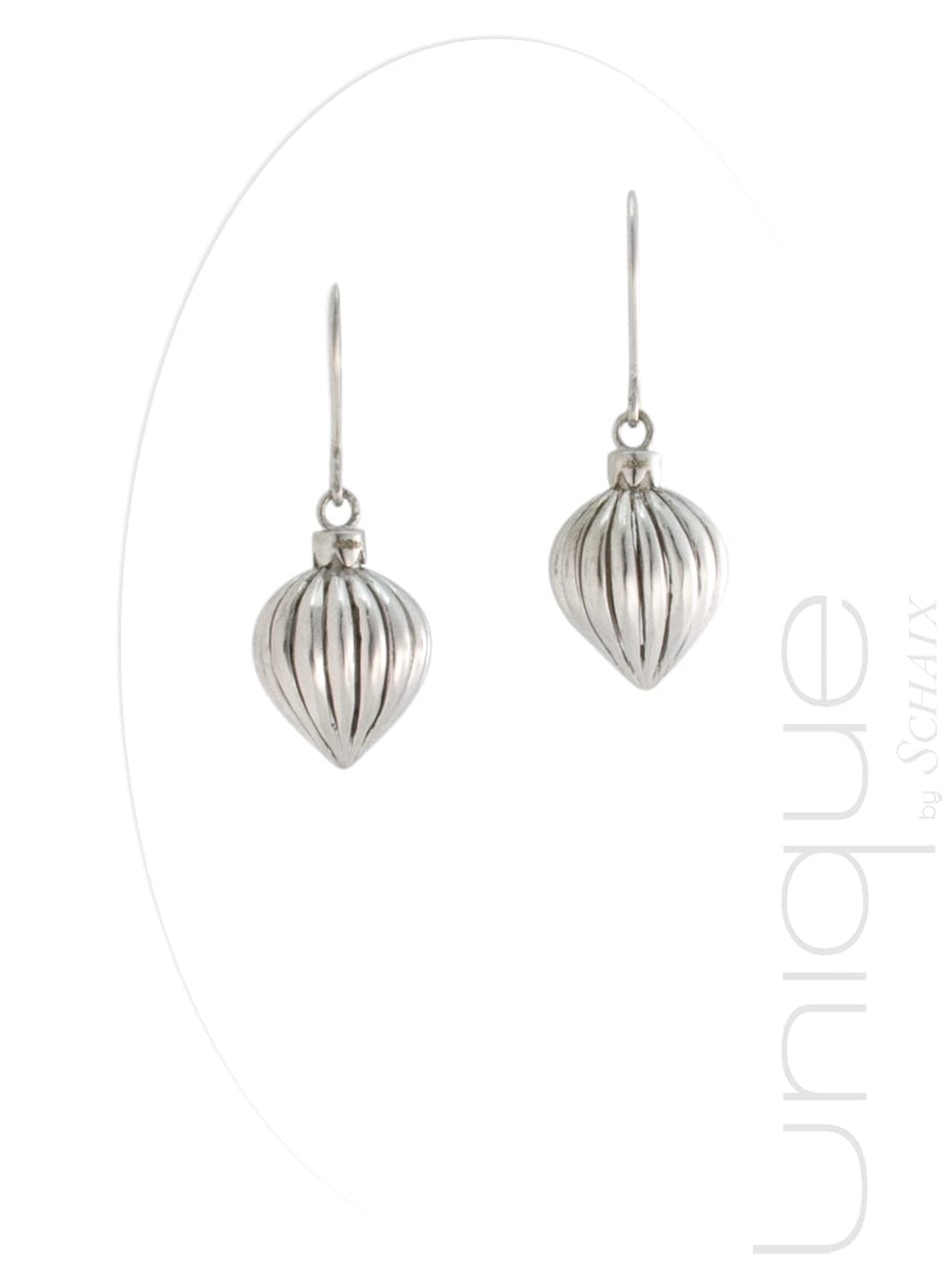 Pear shaped carved silver earrings.