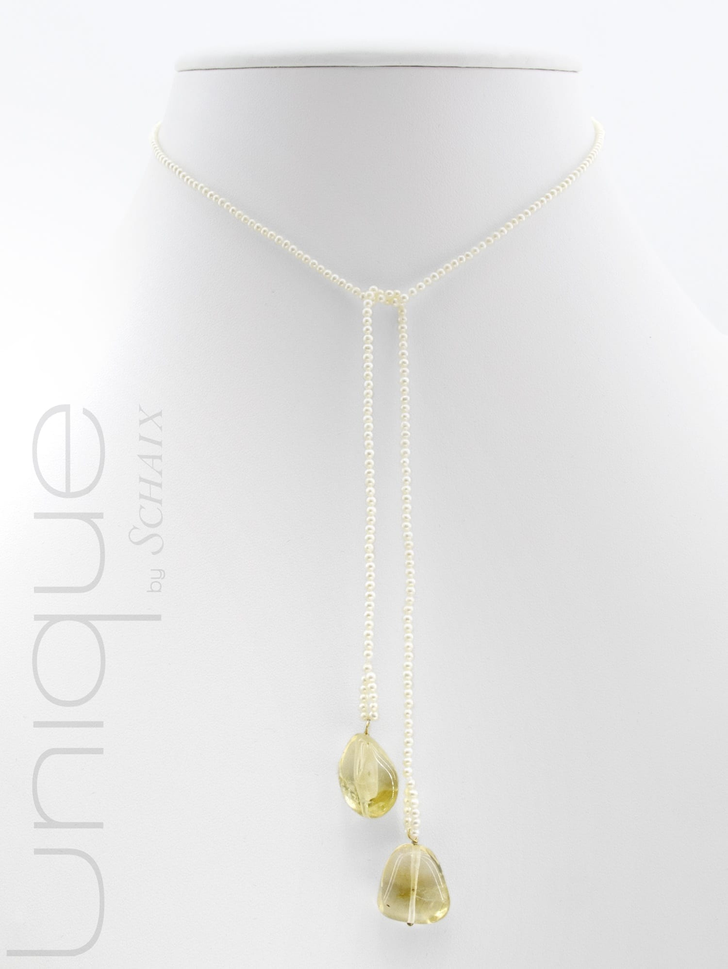 Knotting pearl necklace made of natural freshwater pearls, with two baroque pierced citrine drops built on 18 carat yellow gold.