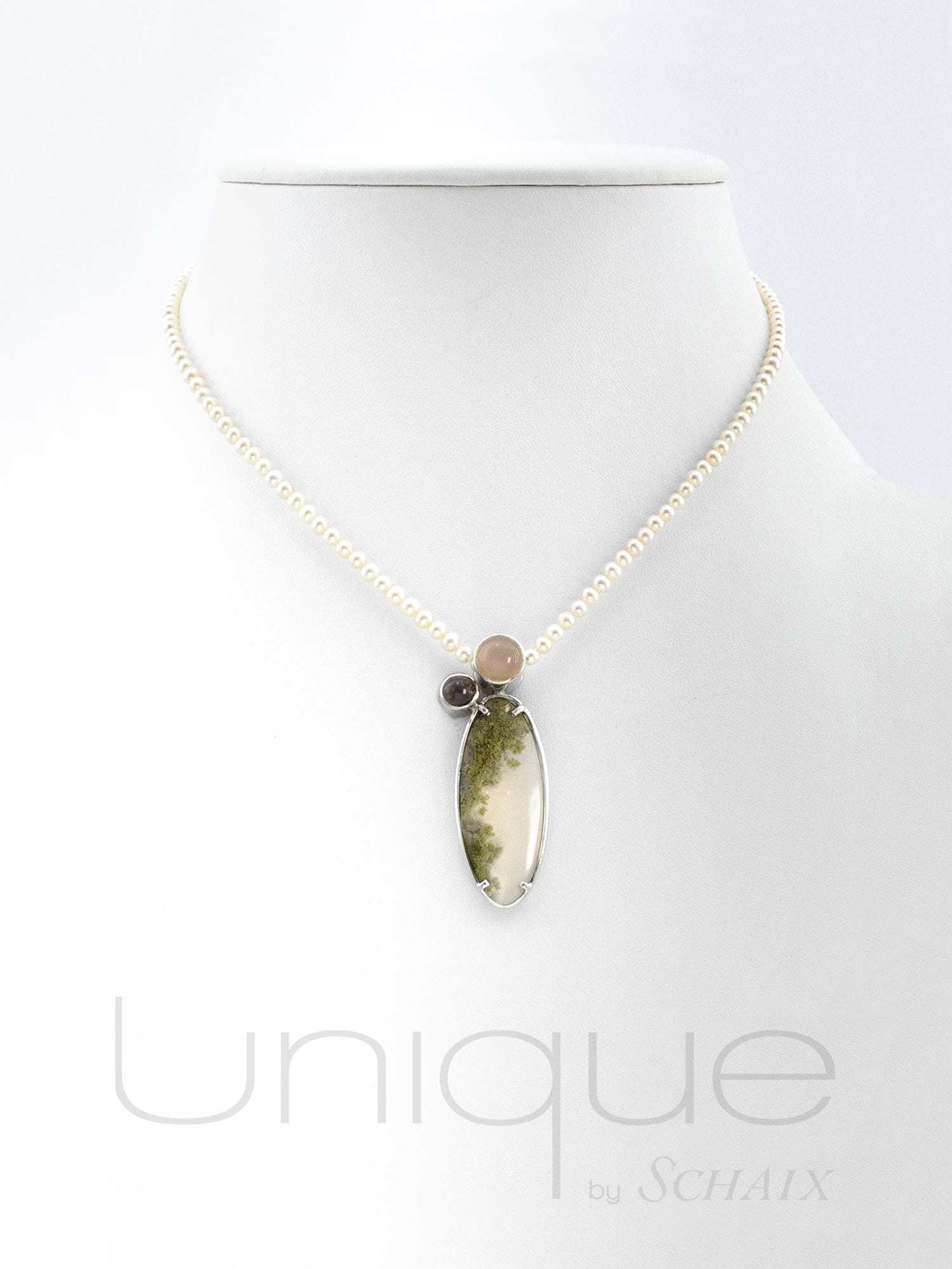 Necklace made of natural freshwater pearls with an oval agate landscape cabochon pendent, topped by a moonstone and a citrine cabochons. Silver clasp.