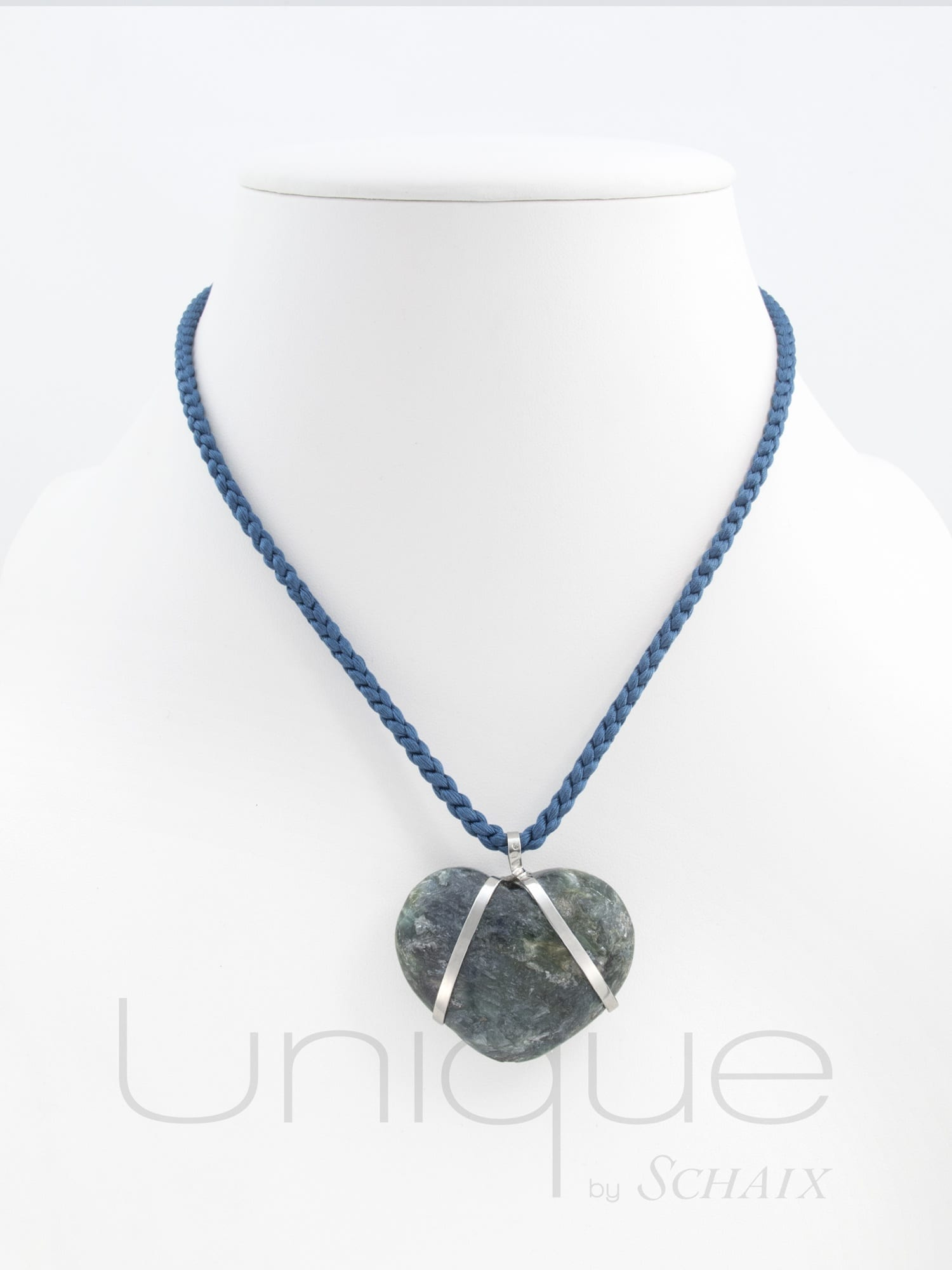 Blue silk thread with a heart shaped cyanite pendant mounted on silver. Signed silver clasp.
