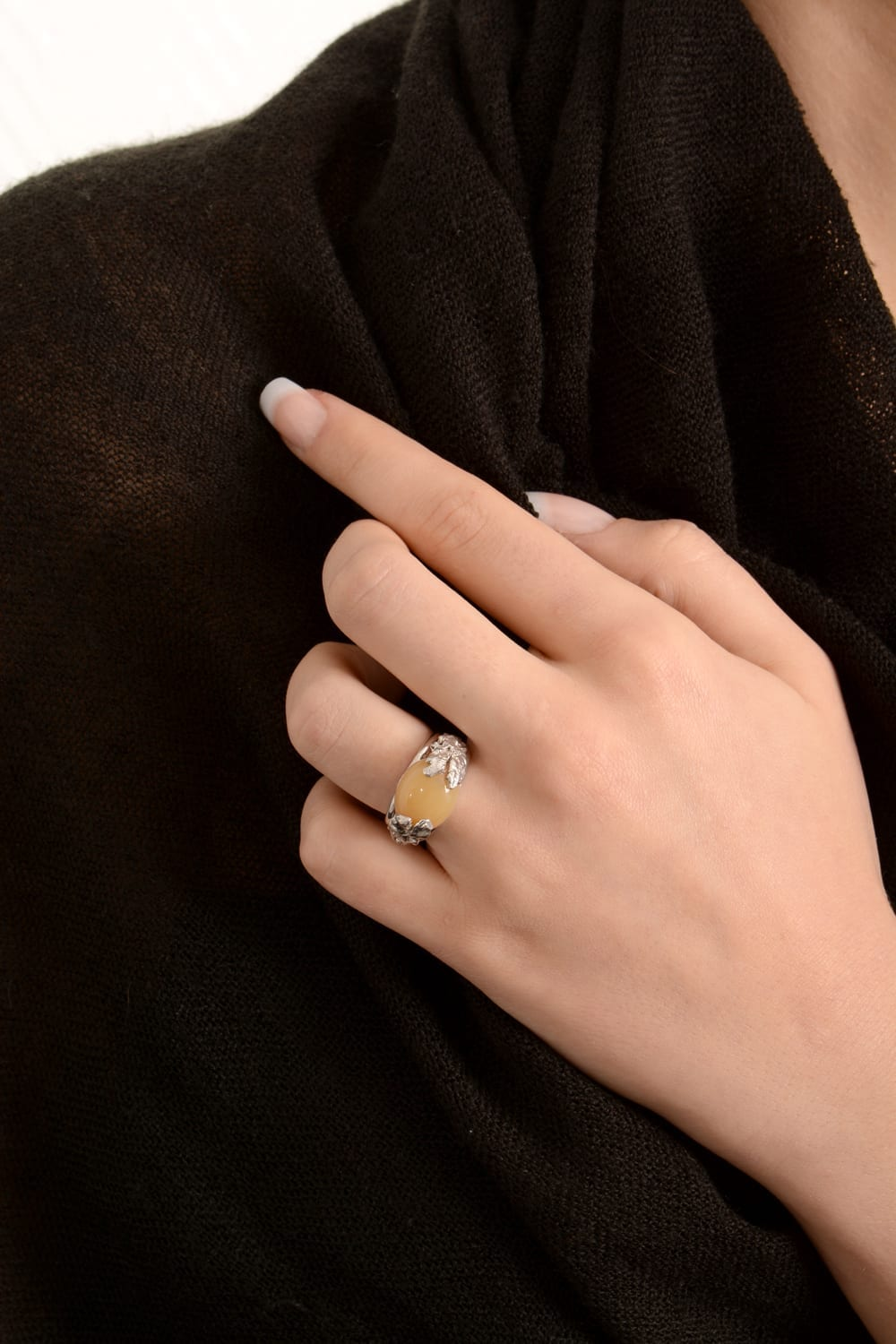 Ring with a yellow moonstone cabochon set in textured silver.