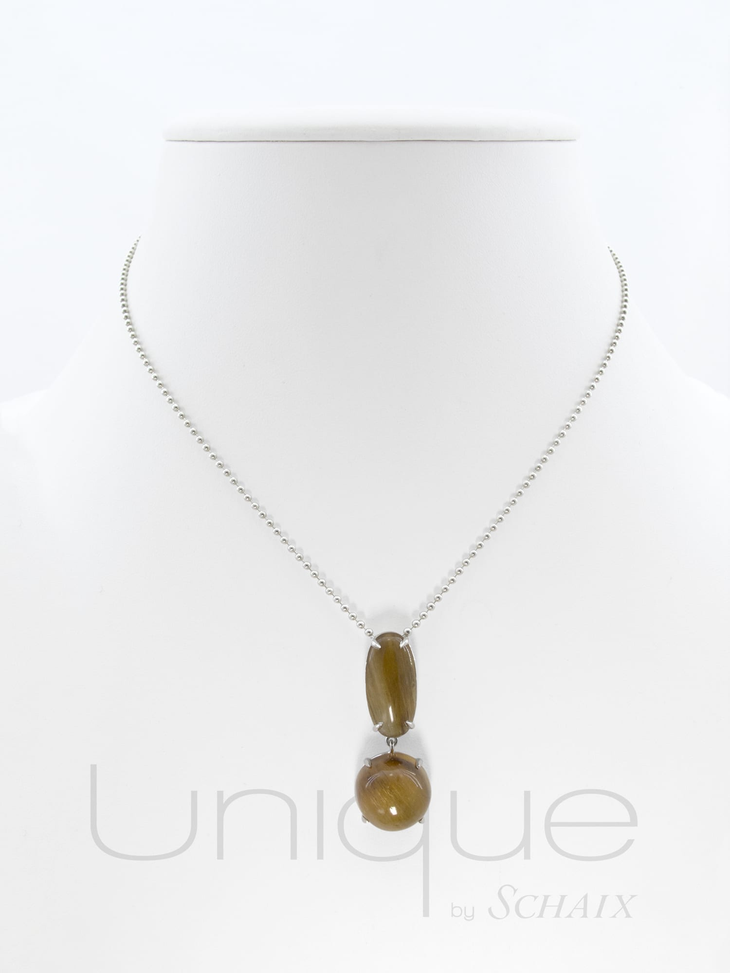 Necklace with a round rutilated quartz cabochon topped with a coordinated oval cabochon in a silver beads chain.