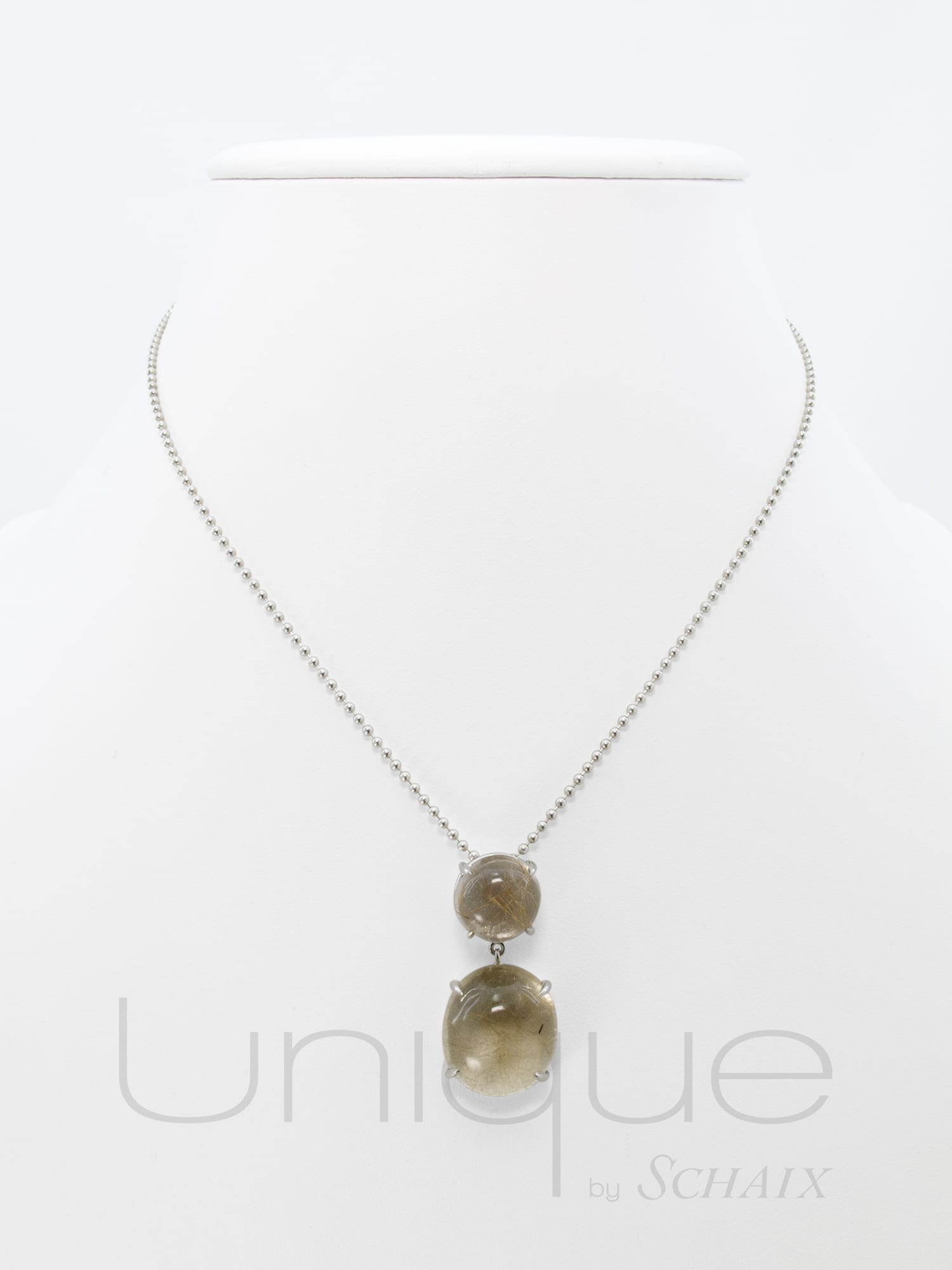 Pendant with a round rutilated quartz cabochon topped with a coordinated cabochon in a silver beads chain.