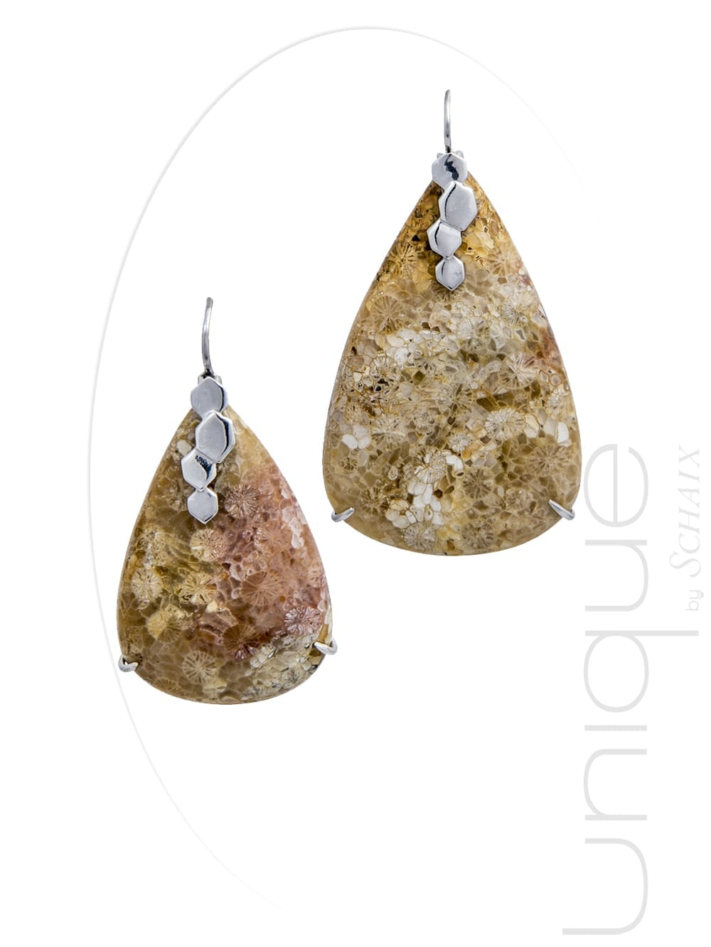 Asymmetric pear-shaped earrings made of fossil coral and silver.